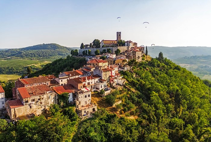Motovun with paragliders