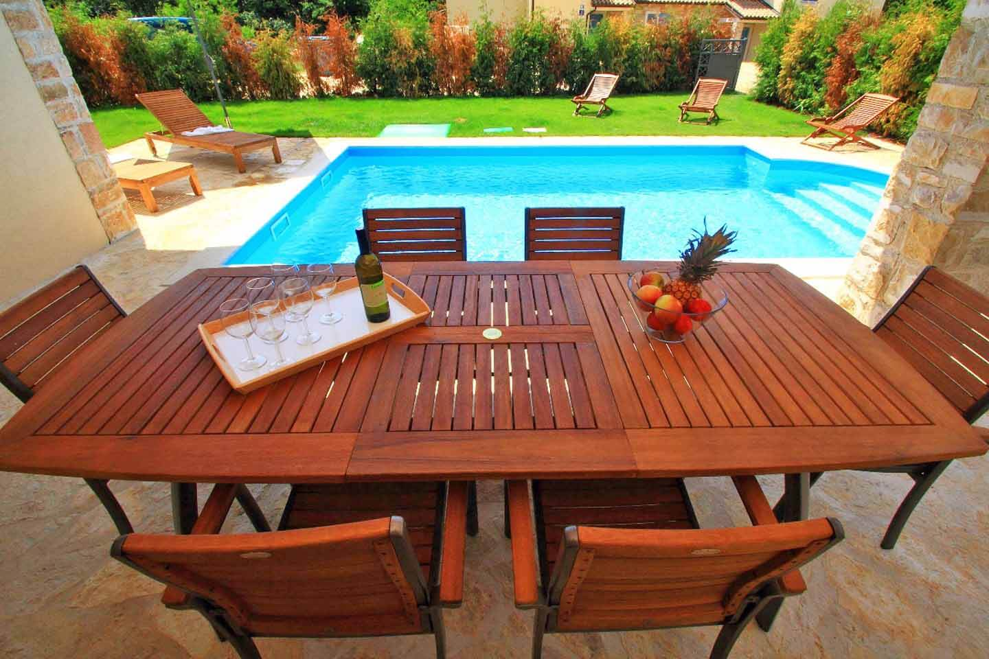 Outdoor dining table and pool