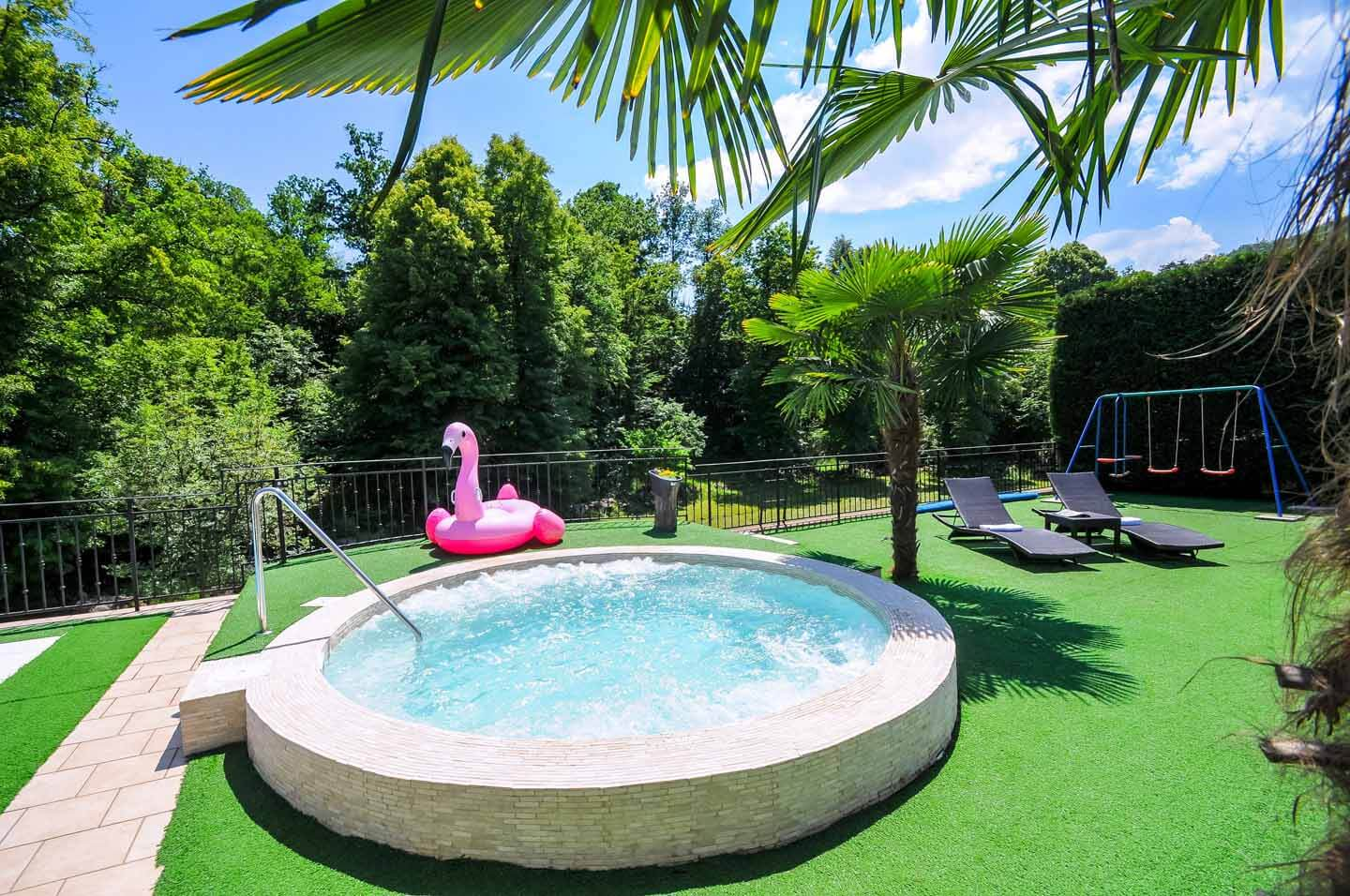 Outdoor play area and jacuzzi