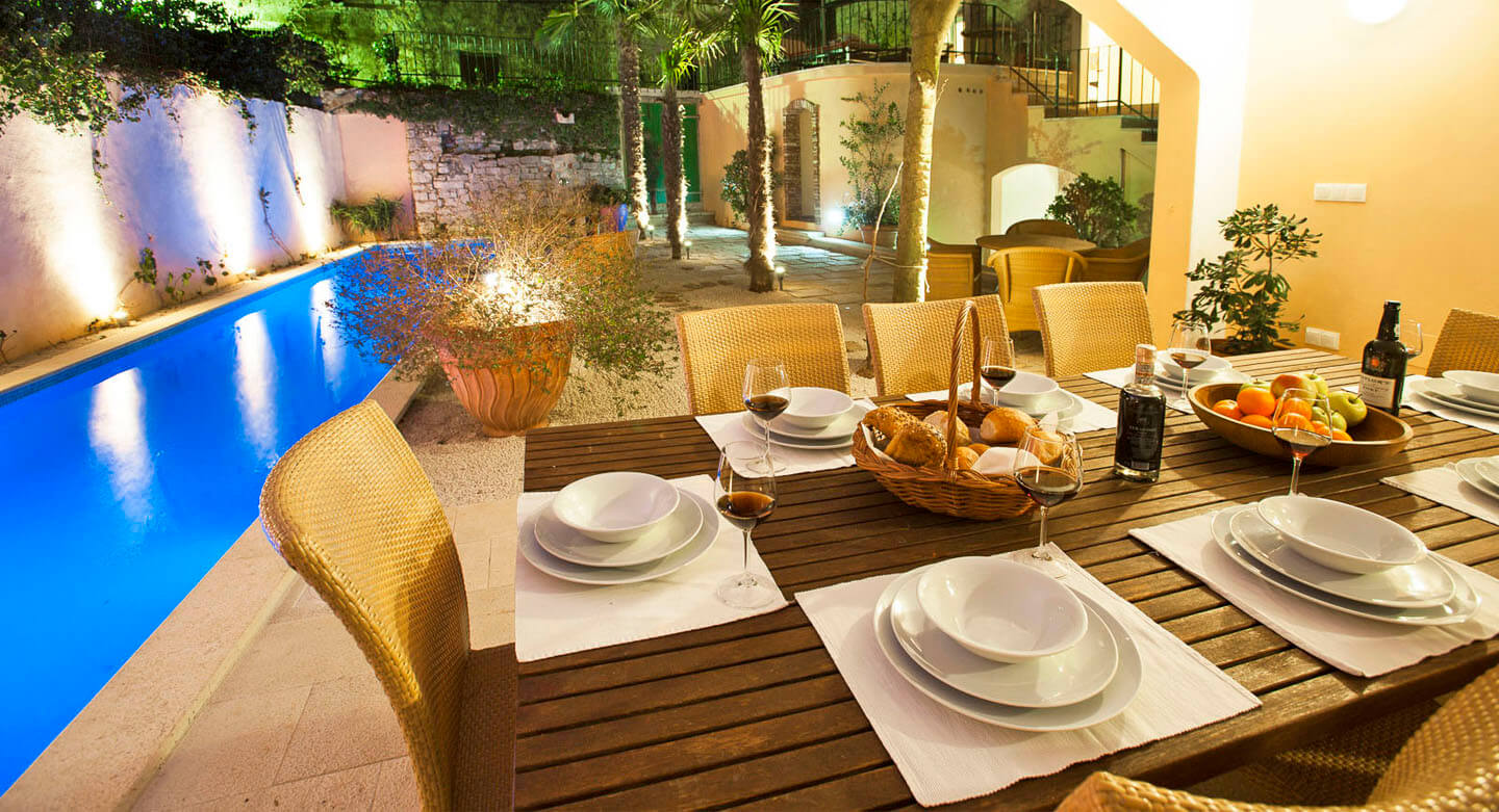 Outdoor swimming pool with dining table