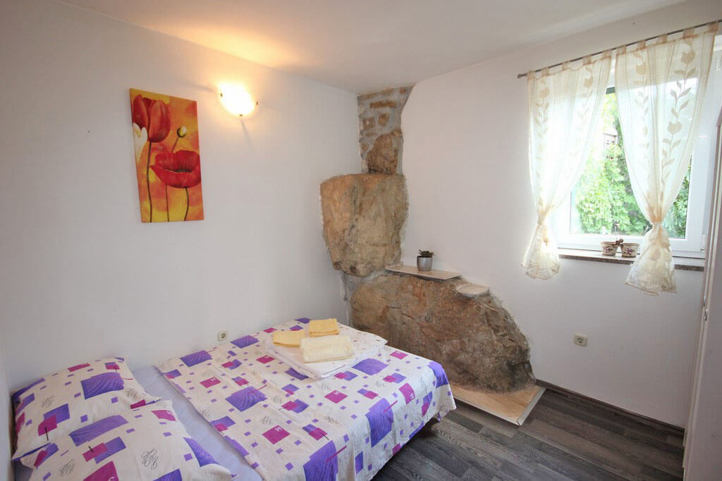 Bedroom with rock feature wall