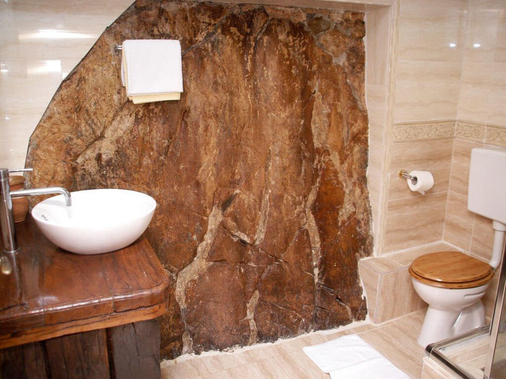 Bathroom with natural rock feature wall