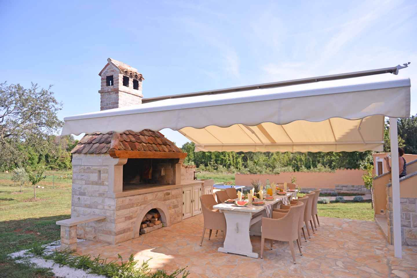 Covered dining terrace and summer kitchen barbecue