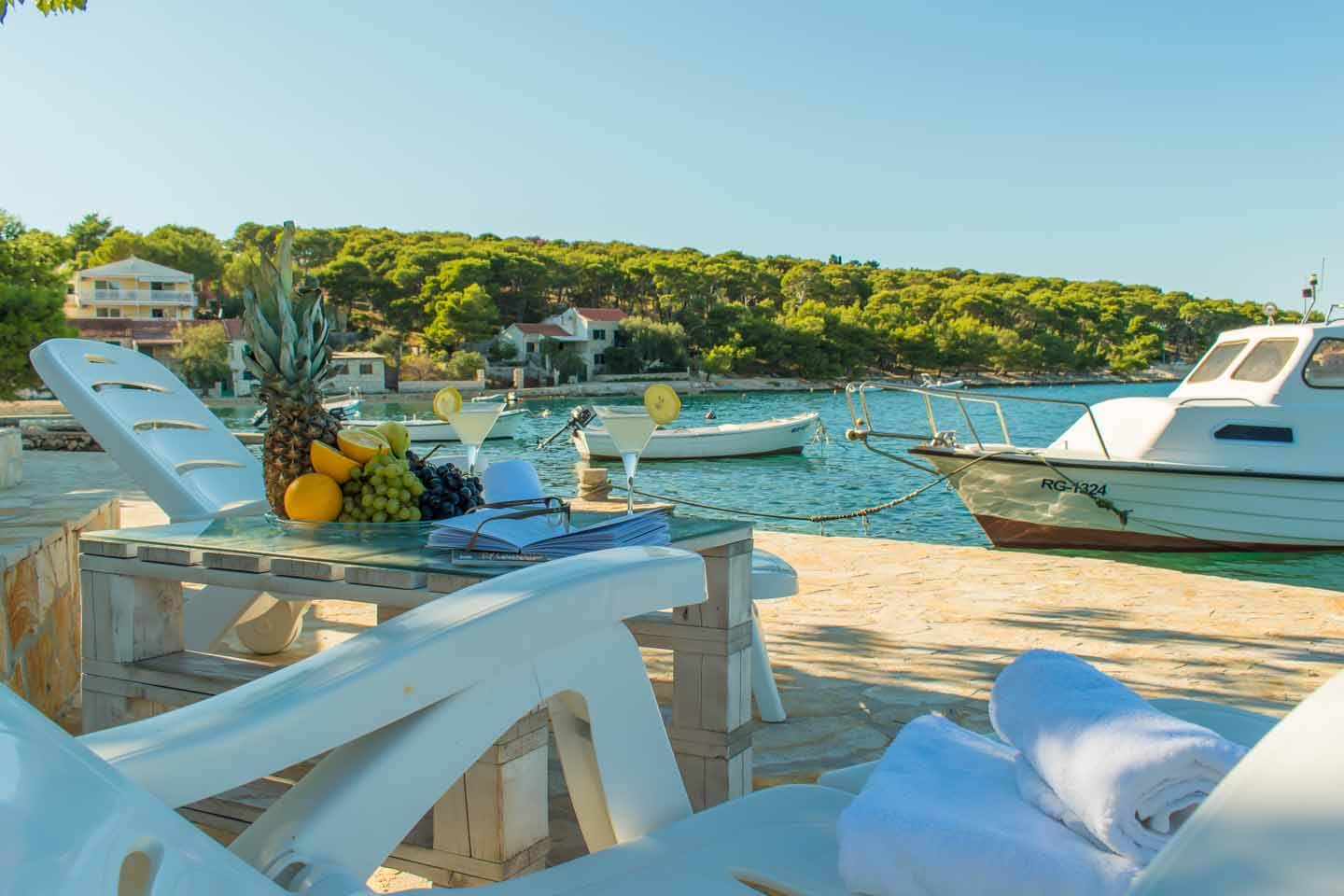 Terrace by the sea with boat mooring