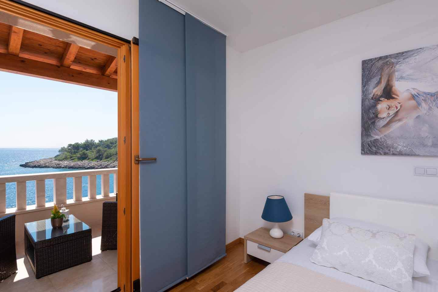 Double bedroom with sea view and direct balcony access one
