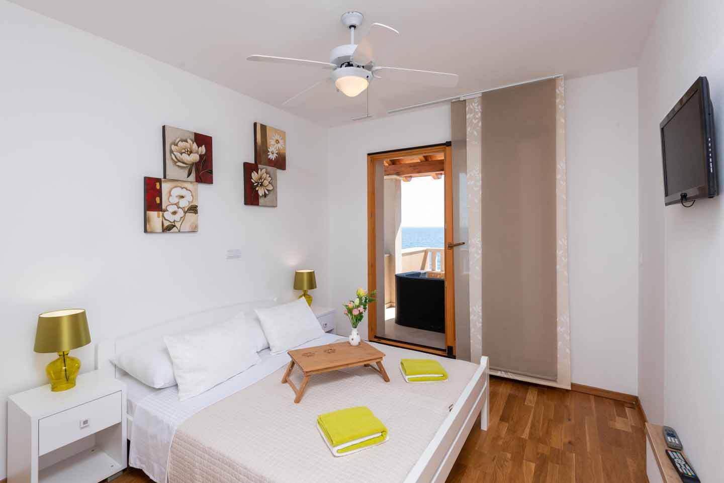 Double bedroom with sea view and direct balcony access three