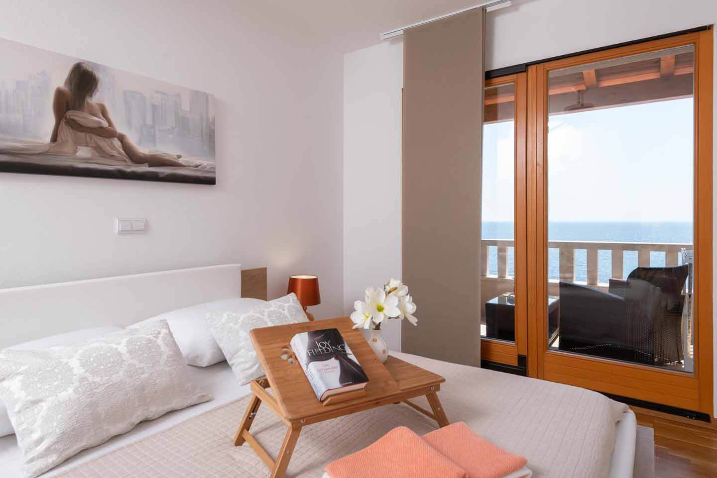 Double bedroom with sea view and direct balcony access two