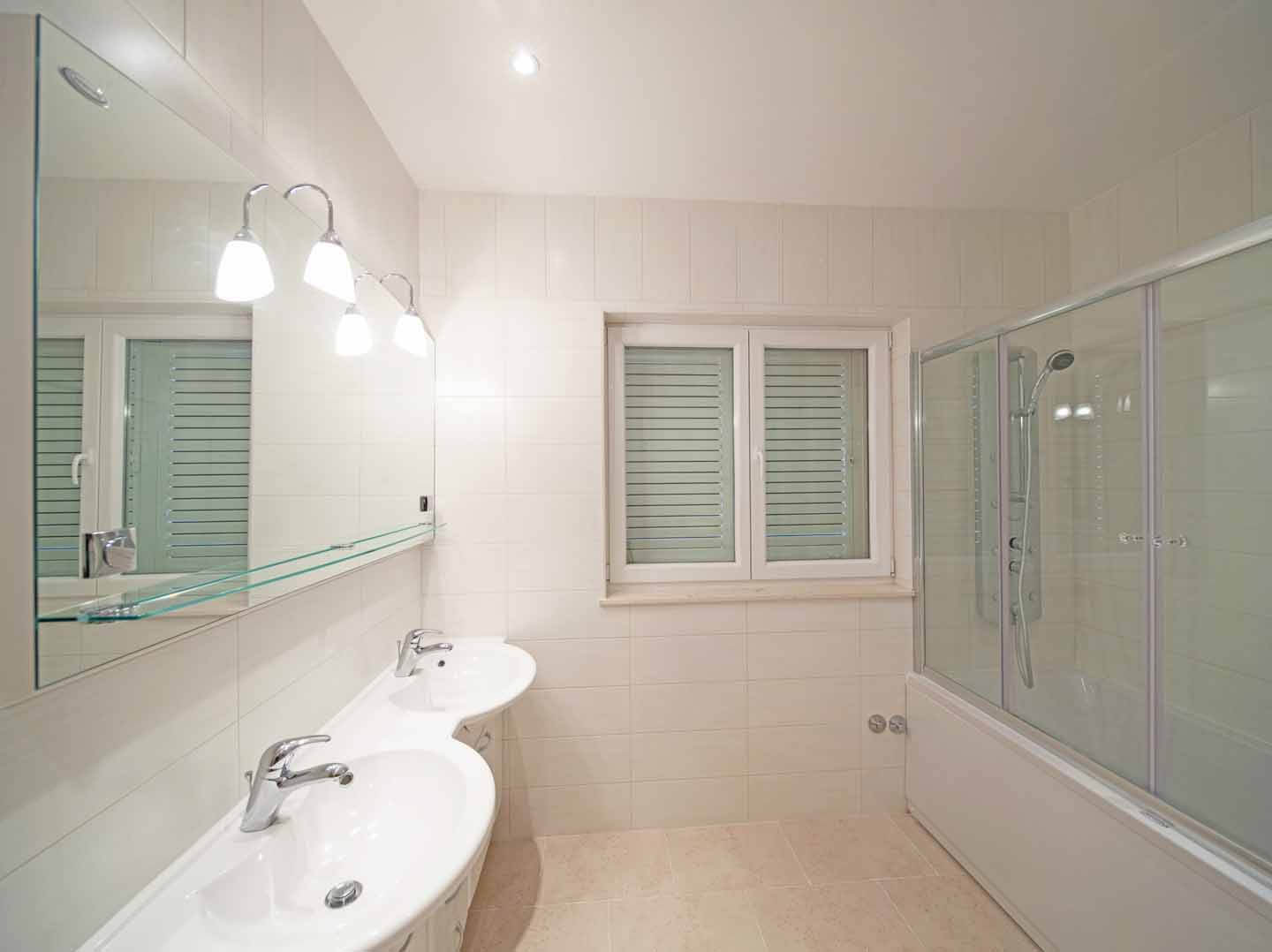 Bathroom with bath tub and shower attachment