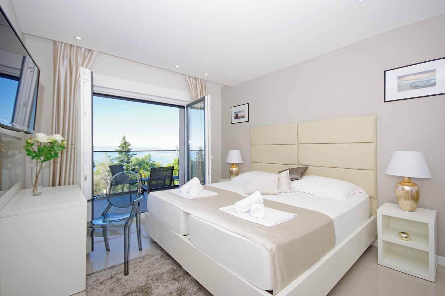 Double bedroom with television and balcony